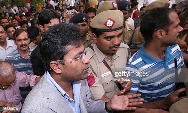 Suspended Indian Premier League Chairman Lalit Modi arrives at Indira Gandhi International Airport's domestic terminal in New Delhi on Wednesday...