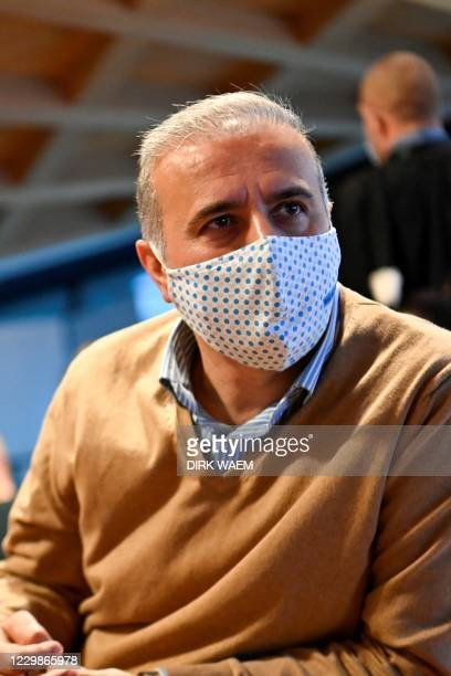 Suspended Mechelen city council member Melikan Kucam is seen ahead of his trial before Antwerp criminal court, along with nine other persons, on...