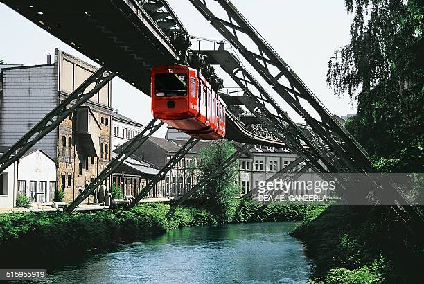 Suspended train along the Wupper River and the old factories Wuppertal monorail suspension railway Germany