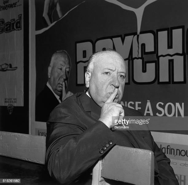 Suspense director Alfred Hitchcoack opens in a mock recreation from a scene in his latest film Psycho which he ia presenting her in Paris.