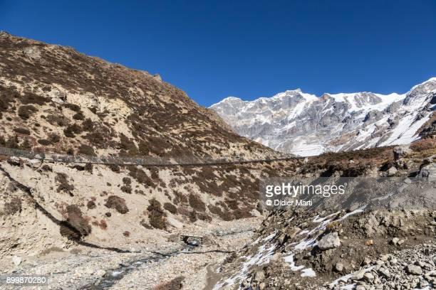 suspension bridge along the annapurna circuit trek in nepal - didier marti stock photos and pictures