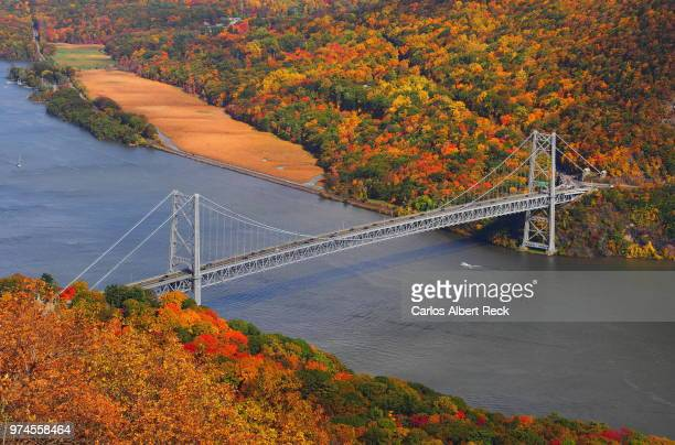 suspension bridge and autumn forest, bear mountain bridge, new york, usa - bear mountain bridge stock pictures, royalty-free photos & images