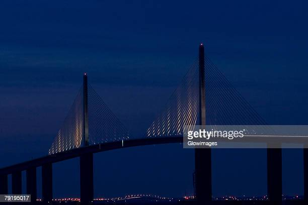 suspension bridge at night, sunshine skyway bridge, st. petersburg, florida, usa - sunshine skyway bridge stock photos and pictures