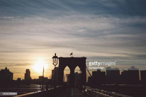 suspension bridge at sunrise - bortes foto e immagini stock