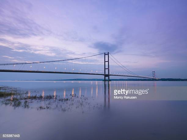 Suspension bridge at sunset. The Humber Bridge, UK was built in 1981 and at the time was the worlds largest single-span suspension bridge