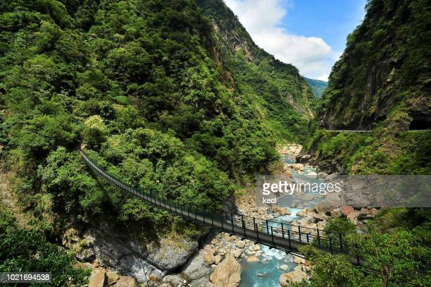 suspension bridge at the taroko national park - hualien county stock pictures, royalty-free photos & images