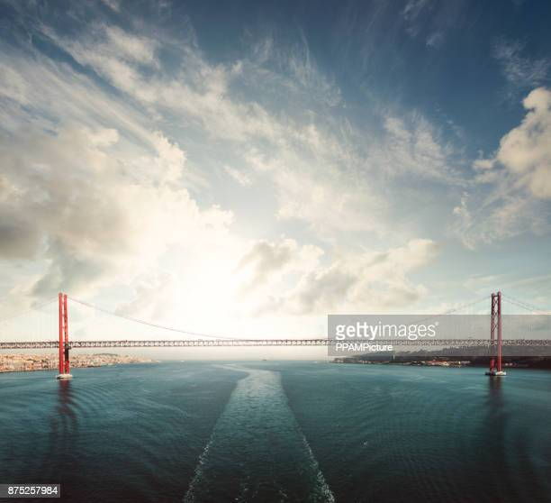 suspension bridge in lisbon, portugal, europe - lisbon portugal stock pictures, royalty-free photos & images