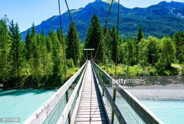 suspension bridge near forchach, lechtaler alps, tyrol, austria - suspension bridge stock photos and pictures