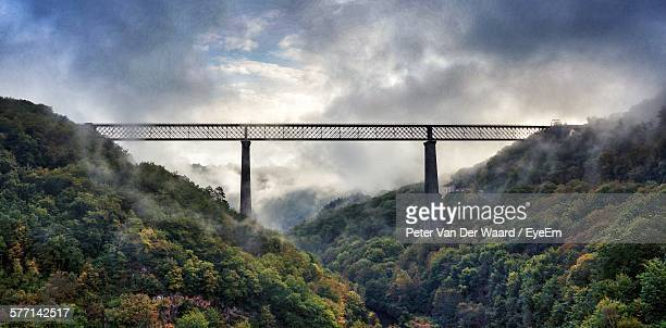 Suspension Bridge On Foggy Day