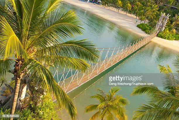Suspension bridge over beautiful lagoon