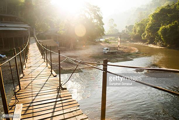 a suspension bridge over mae taeng river in the forest north of chiangmai - footbridge stock photos and pictures