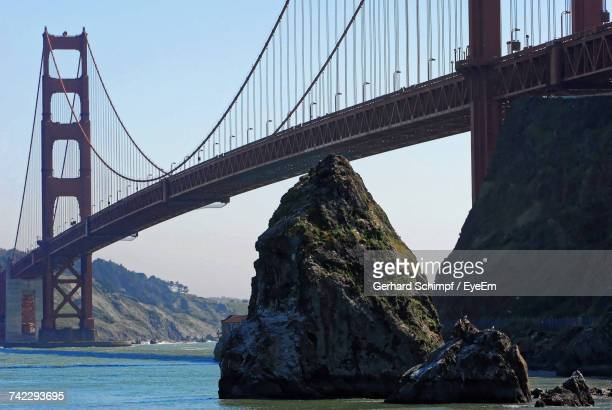 suspension bridge over river - gerhard schimpf stock photos and pictures