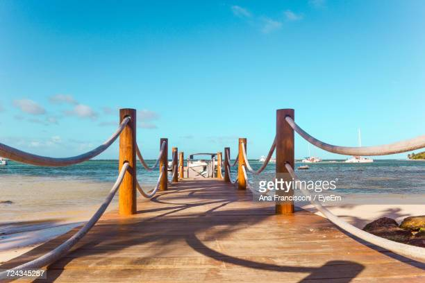 suspension bridge over sea against clear blue sky - punta cana fotografías e imágenes de stock