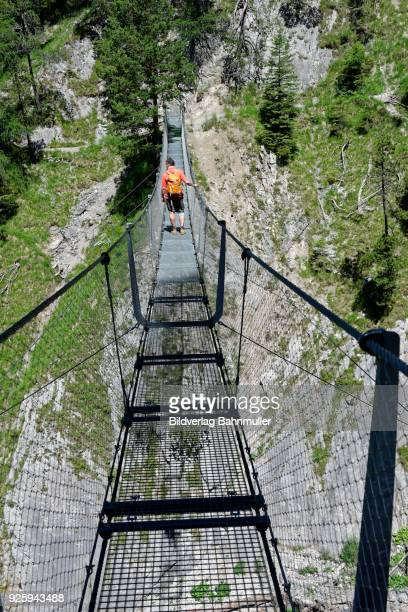 suspension bridge over the sulzleklamm, karwendel mountains, mittenwald, werdenfelser land, upper bavaria, bavaria, germany - mittenwald stock pictures, royalty-free photos & images