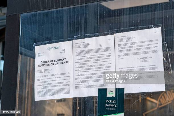 Suspension of License Order pinned on a window of M.I.A Restaurant Lounge in Astoria after the State Liquor authority suspended its liquor license...