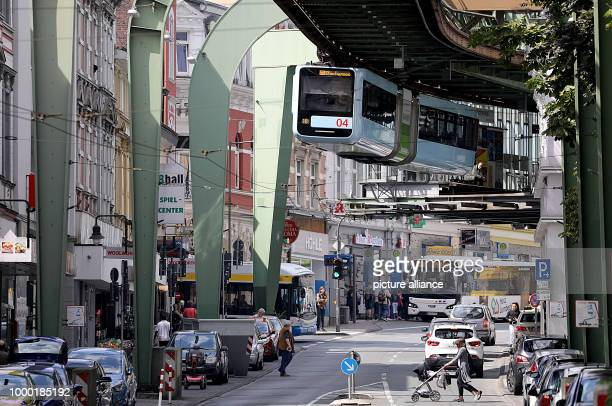 A suspension railway train makes its way through the city of Wuppertal Germany 26 June 2017 Photo Oliver Berg/dpa