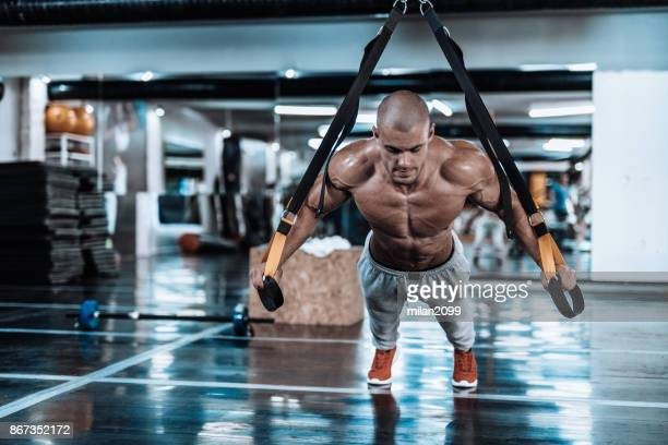Suspension straps exercise in the gym