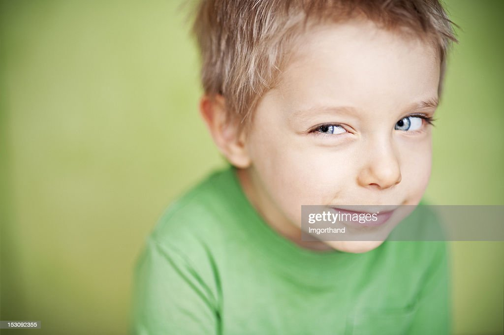 Suspicious funny green boy : Stock Photo