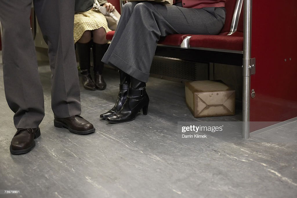 Suspicious package under seat in subway train : Stock Photo