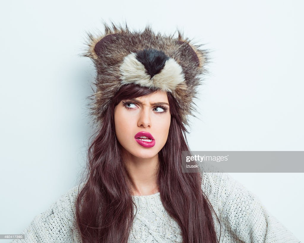 Suspicious woman wearing fur cap : Stock Photo