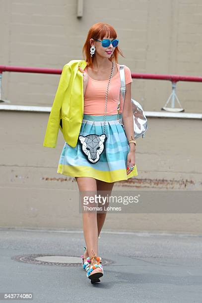 Sussan Zeck is wearing a jacket by Christian Pellizzari a skirt bei HOPPER a bag and bracelet by Marc Cain and shoes by Moda Espana during the...