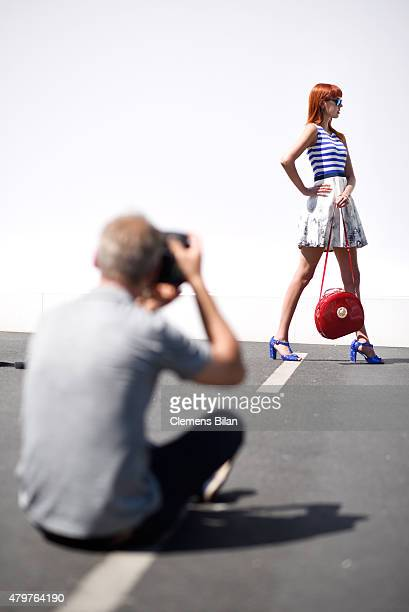 Sussan Zeck poses for a photo outside the main tent entrance during the MercedesBenz Fashion Week Berlin Spring/Summer 2016 at Brandenburg Gate on...