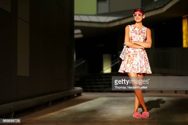 Sussan Zeck wearing Asos shoes Emu Australia and visor River Island poses during a street style photo session on July 2 2018 in Berlin Germany