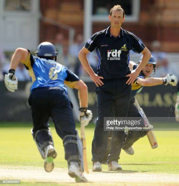 Sussex bowler Robin MartinJenkins looks on as Hampshire batsmen Michael Lumb and Jimmy Adams take another run during the Friends Provident Trophy...