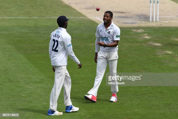 Sussex pace bowlers Jofra Archer and Chris Jordan have a chat during the fourth day of the Specsavers County Championship Division Two match between...