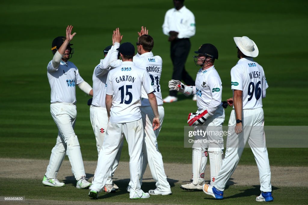 Sussex players celebrate with Danny Briggs after another wicket during day three of the Specsavers County Championship: Division Two match between Sussex and Middlesex at The 1st Central County Ground on May 6, 2018 in Hove, England.