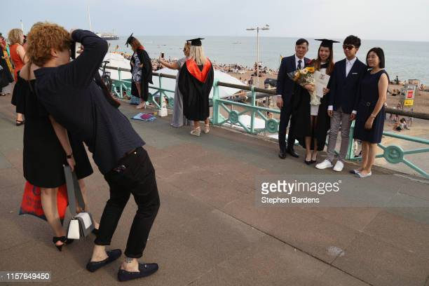 Sussex University students celebrate their graduation on the seafront on July 25 2019 in Brighton United Kingdom The Met Office issued a weather...