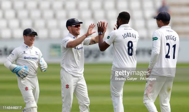 Sussex's Chris Jordan celebrates with his teammates after Northamptonshire's Brett Hutton is caught out during day three of the Specsavers County...