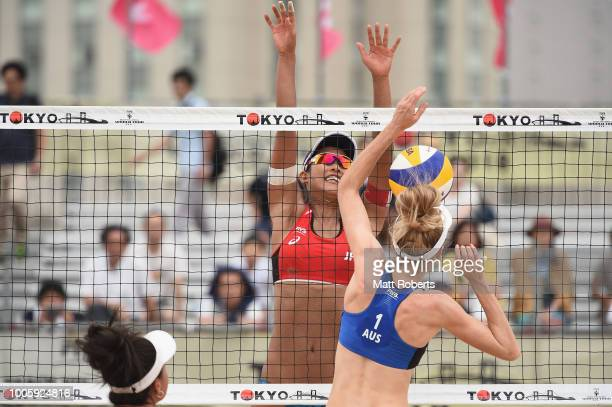Susuka Hashimoto of Japan blocks a shot by and Phoebe Bell of Australia during the Women's Pool H match between Sayaka Mizoe and Susuka Hashimoto of...