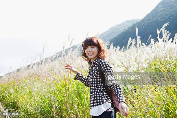 Susuki grass and young woman.