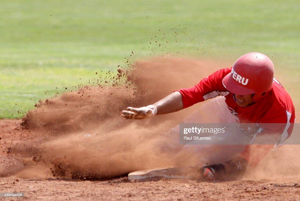 Susumo Yoza of Peru steals a base during the baseball qualifiers as part of the XVII Bolivarian Games Trujillo 2013 at Villa Regional del Callao on November 18, 2013 in Lima, Peru.
