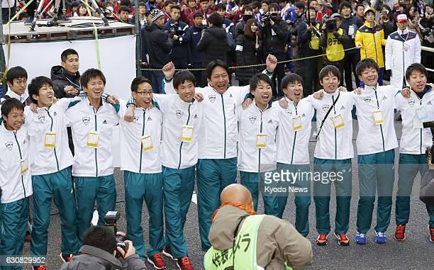 Susumu Hara , manager of the Aoyama Gakuin University Tokyo-Hakone collegiate ekiden road relay team, celebrates in Tokyo as the team wins the...