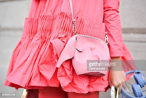 Susy Lau poses wearing a Molly Goddard top and Loewe purse before Bouchra Jarrar show during Haute Couture on January 26 2016 in Paris France
