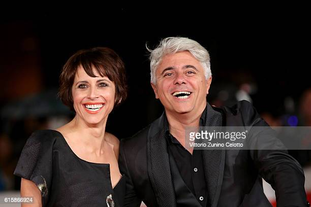 Susy Laude and Dino Abbrescia walk a red carpet for 'Florence Foster Jenkins' during the 11th Rome Film Festival at Auditorium Parco Della Musica on...