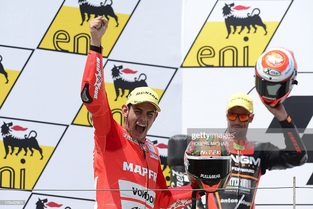 Suter driver Jordi Torres of Spain celebrates his win on the podium after competing in the Moto2 race Grand Prix Germany at the Sachsenring Circuit on July 14, 2013 in Hohenstein-Ernstthal, eastern Germany.