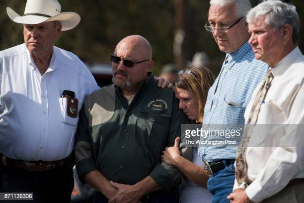 Sutherland Springs First Baptist Church Pastor Frank Pomeroy and his wife Sherri Pomeroy stand with officials during a press conference near their...