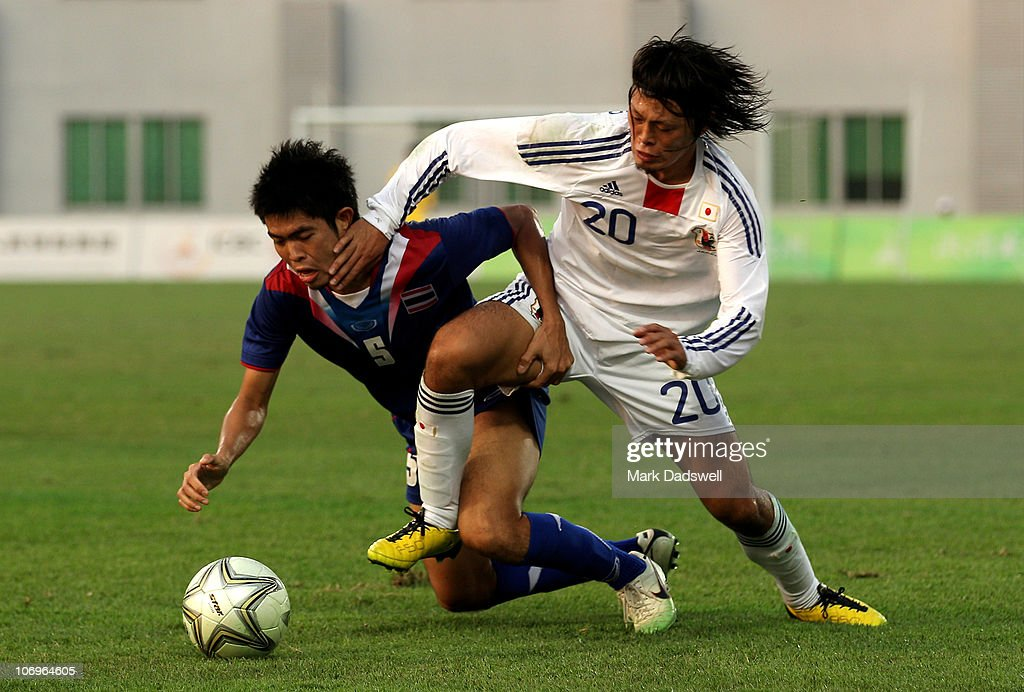 suttinun phukrom of thailand and takamitsu tomiyama of japan battle picture id106964605?k=6&m=106964605&s=612x612&w=0&h=ah6OL1b bItW81aqUtt1GId83XBE20z2HxhnnTjwj g= - Asian Games Football 2010