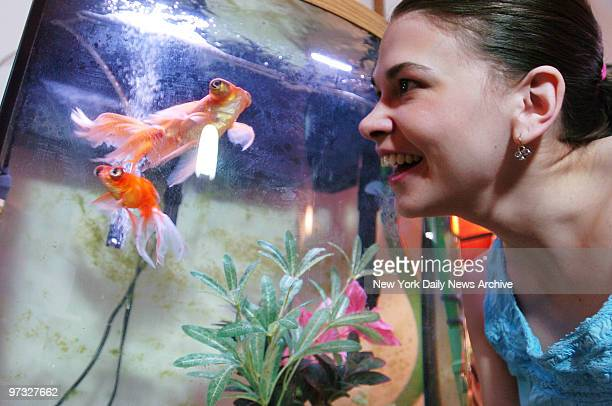 Sutton Foster gazes lovingly at one of her seven pet goldfish in her prewar onebedroom apartment in midtown Manhattan Many of her fish named Darth...