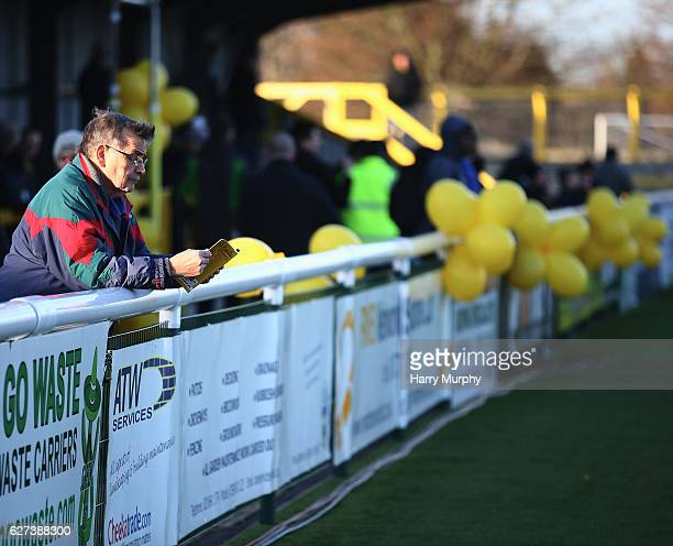 Sutton United fan reads the match program prior to The Emirates FA Cup Second Round between Sutton United and Cheltenham Town on December 3 2016 in...