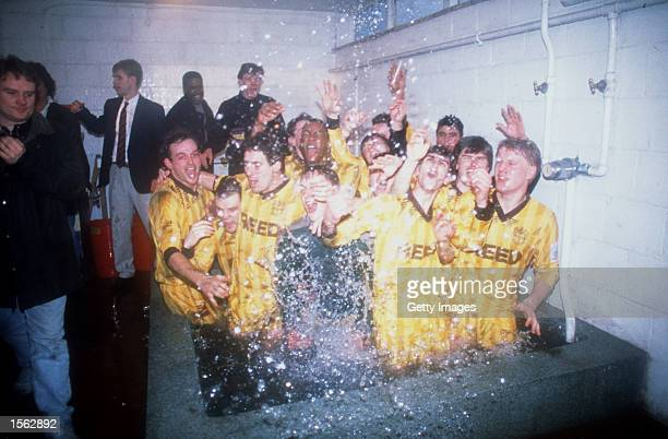 Sutton United players celebrate in the bath after the FA Cup 3rd Round match between Sutton United and Coventry City at Gander Green Lane in Sutton...