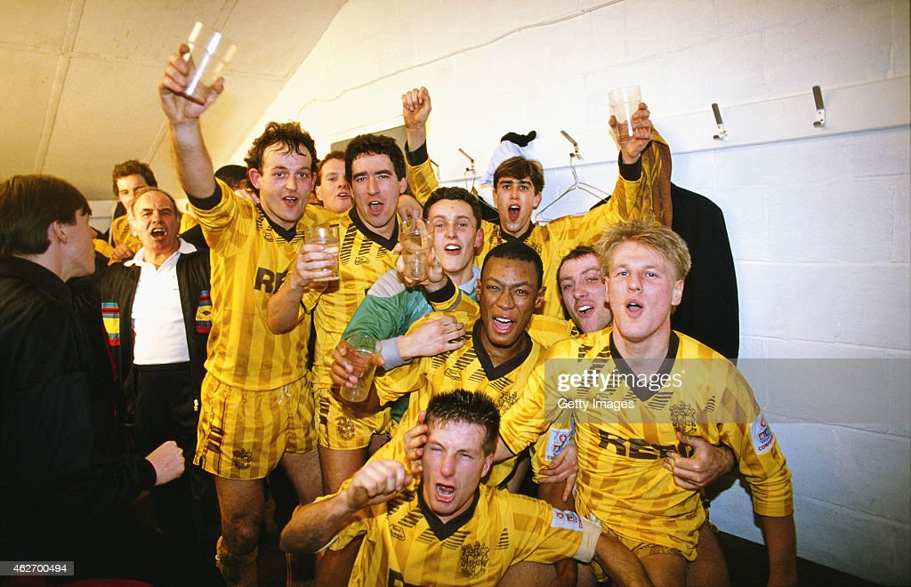 Sutton United players including goalscorers Tony Rains (2nd left) and Matthew Hanlan (right, both hands raised) celebrate in the dressing room after the FA Cup 3rd Round match between Sutton United and Coventry City at Borough Sports Ground on January 7, 1989 in Sutton, England, Sutton produced one of the most famous 'giant-killings' in the competition's history, notable for being one of those rare occasions when a club from the highest tier of English football was defeated by a non-League side, Sutton won the match 2-1.