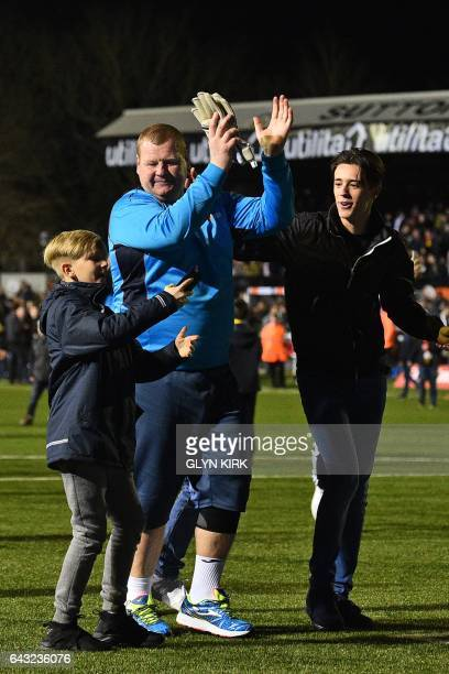 Sutton United's English goalkeeper Wayne Shaw applauds supporters on the pitch after the English FA Cup fifth round football match between Sutton...