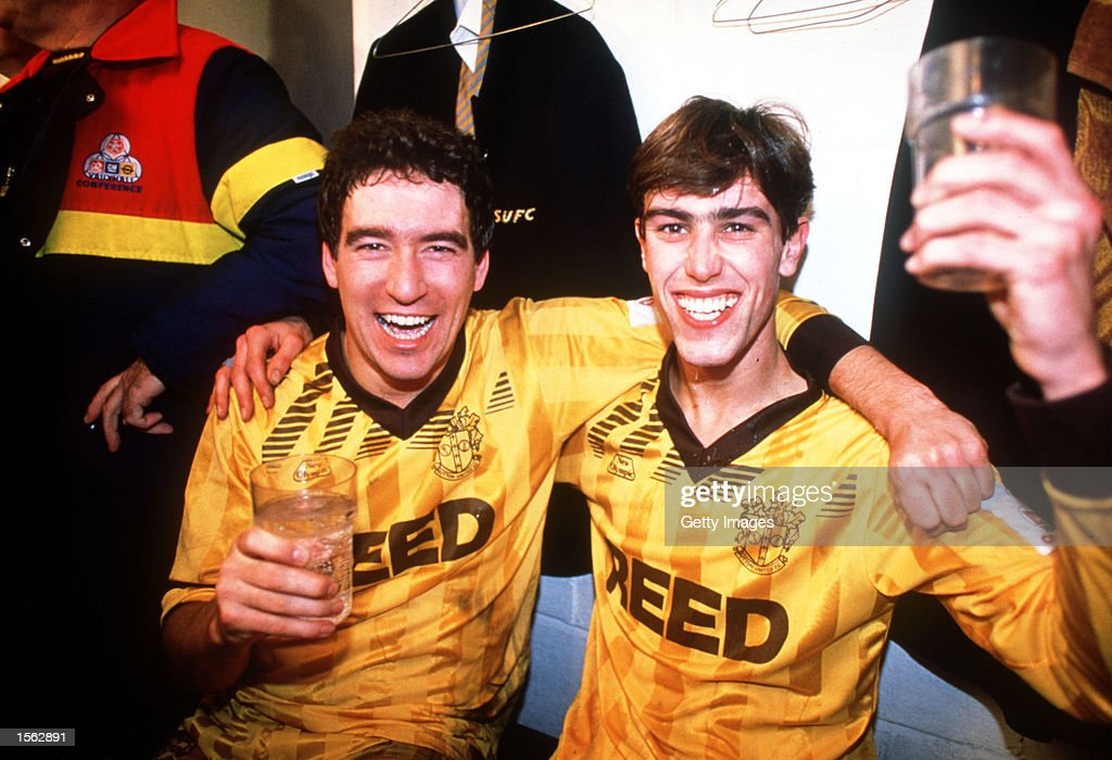 Sutton United's Tony Rains and Matthew Hanlan celebrate after the FA Cup 3rd Round match between Sutton United and Coventry City at Gander Green Lane in Sutton, England, Sutton produced one of the most famous 'giant-killings' in the competition's history, notable for being one of those rare occasions when a club from the highest tier of English football was defeated by a non-League side, Sutton won the match 2-1.