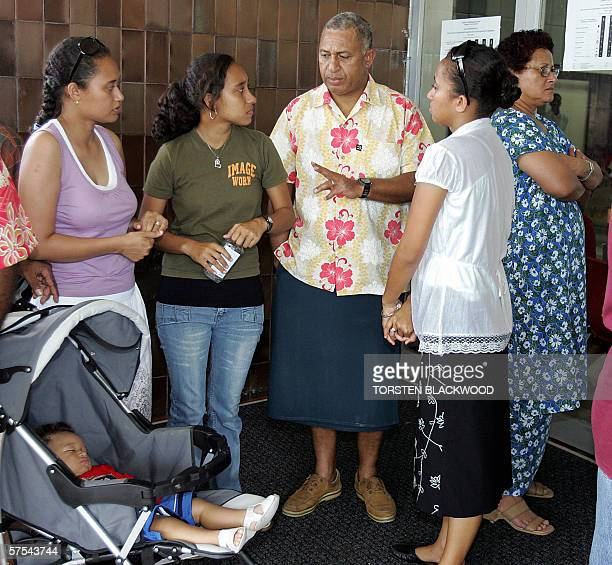 Fijian military commander Commodore Voreqe Bainimarama queues with his ninemonthold grandson David wife Mary and daughters Francis Bernadette and...