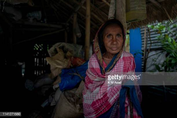 Suvashi 80 years old take shelter in a neighbor's house in Dakop as Cyclone Fani approaches Bangladesh