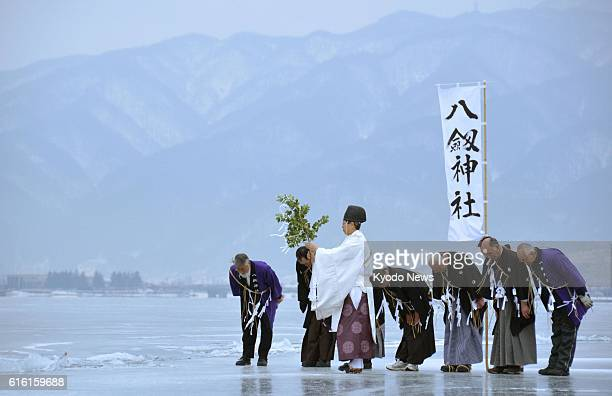 Suwa, Japan - A Shinto ritual is held on the surface of the frozen Lake Suwa in Nagano Prefecture on Feb. 6, 2012 to predict the year's social...